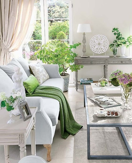 For a smaller commitment to the color, buy a few accent pillows and throws while indulging in lots of fresh flowers and greenery in vases.