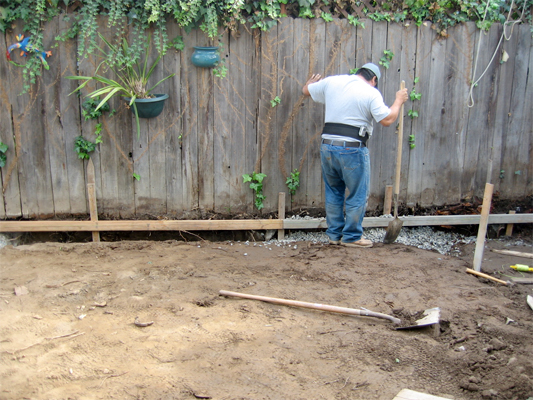 Even if you rent a trenching tool, there's still going to be a lot of digging involved in a French drain system installation. Image: EOShea/Flickr